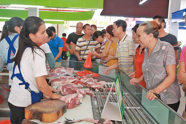 """为满足市民生活需求 海南儋州市""""放心猪肉""""销售点增至37个"""